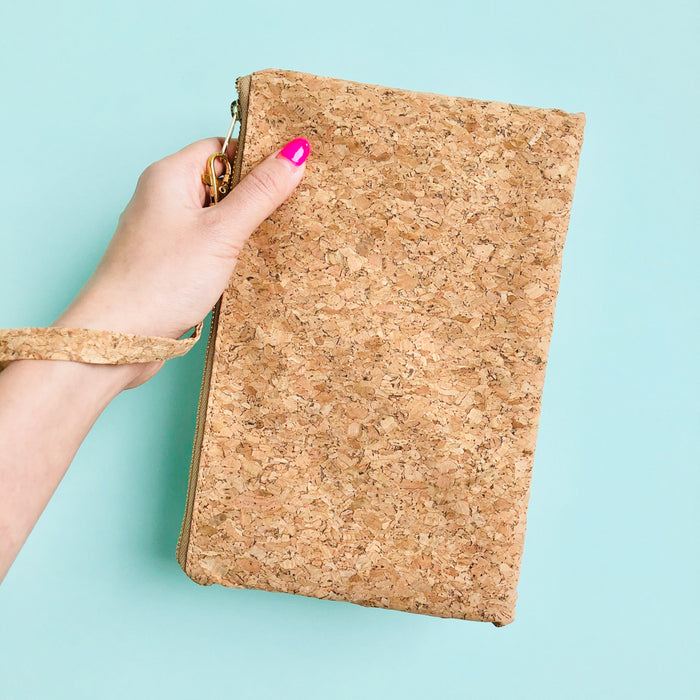 Woman using wristlet of By The Sea Collection, Annie, vegan cork leather pouch