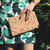 Woman holding By The Sea Collection, Annie, colourful vegan cork leather pouch