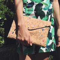 Woman holding multicoloured Aurora Cork Bag - Ethically sourced and vegan friendly.