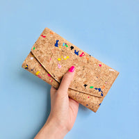Hand holding By The Sea Collection, Emma, colourful women's vegan cork leather wallet