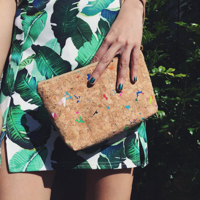Woman holding By The Sea Collection, Miley, colourful vegan cork leather make up bag