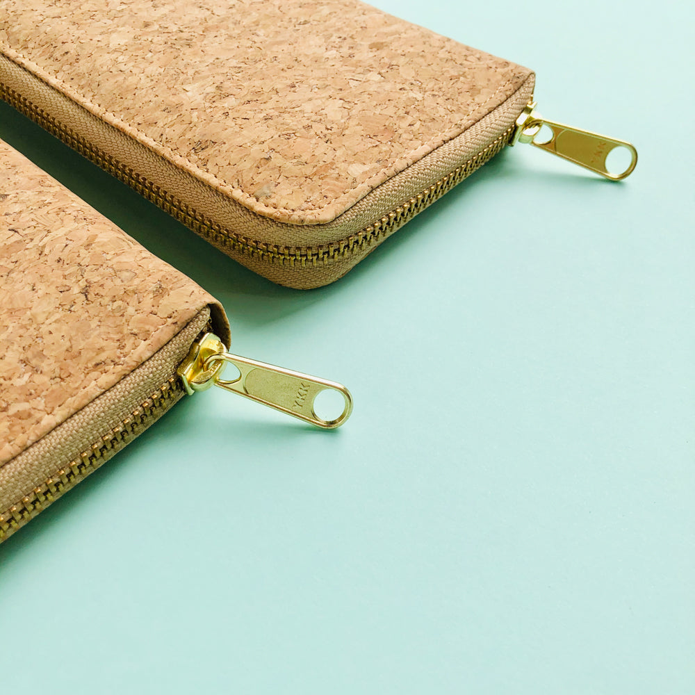 YKK metal zipper detail of two By The Sea Collection, Iggy, women's vegan cork leather wallets