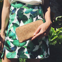 Women holding By The Sea Collection, Iggy, women's vegan cork leather wallet