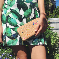 Women holding By The Sea Collection, Iggy, colourful women's vegan cork leather zipper wallet