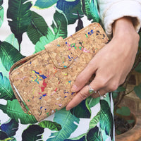 Women holding By The Sea Collection, Izzy, colourful vegan cork leather women's wallet