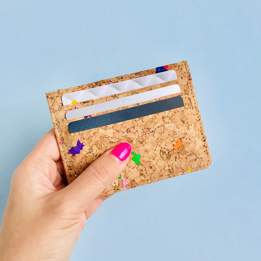 Woman holding of By The Sea Collection, Max, colourful vegan cork leather card holder full of cards