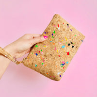 Woman using wristlet of By The Sea Collection, Miley, colourful vegan cork leather make up bag