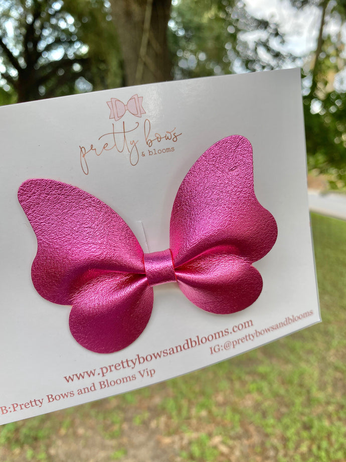 Metallic dark pink butterfly