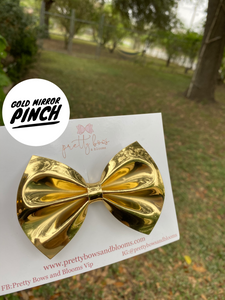 Gold mirror pinch bow