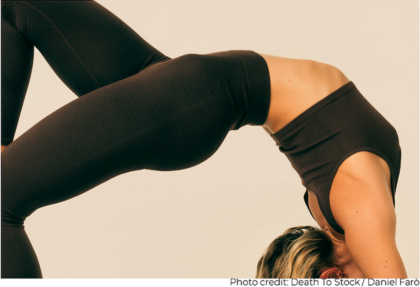 Woman stretching for physical self-care Death to Stock Photo by Daniel Faro