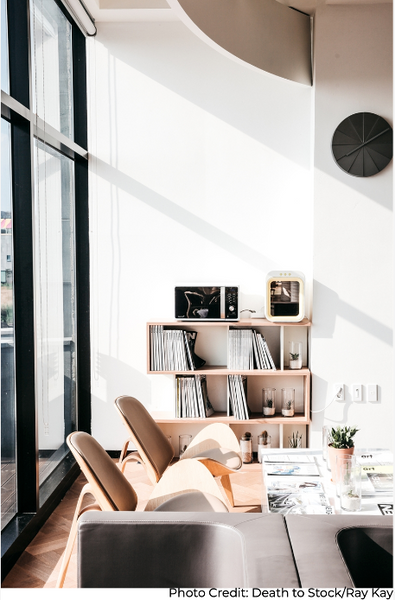 Home space with two chairs and a book shelf that influences well-being