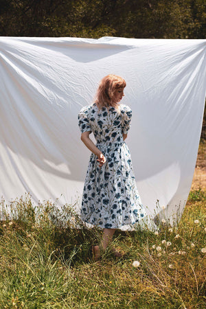 I found Lucy summer Frida Prairie Cotton dress with blue cornflower print view of back