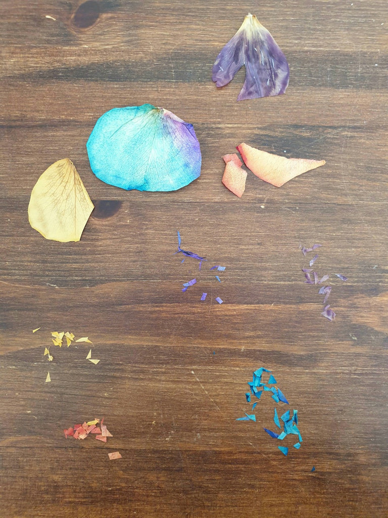 torn up flower petals on a wooden background