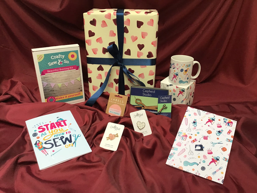 A selection of Valentines gifts for sewists on a red background