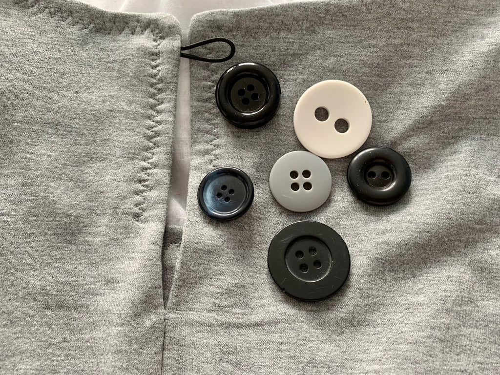 An array of buttons for the Everyday Amazing top