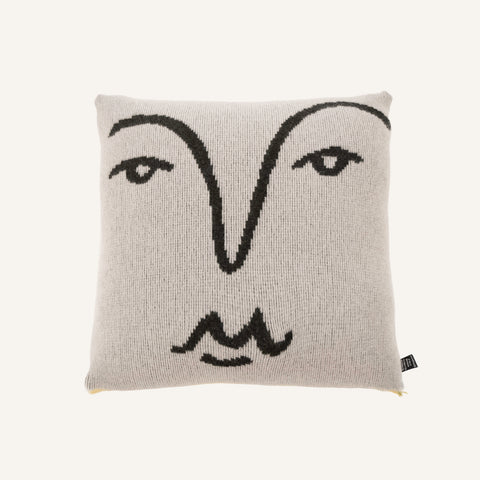 white merino cushion with black line drawing of a face