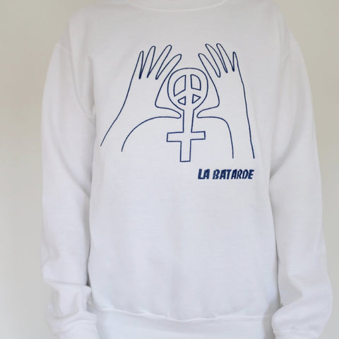 white sweatshirt with embroidered hands and feminist peace sign in blue