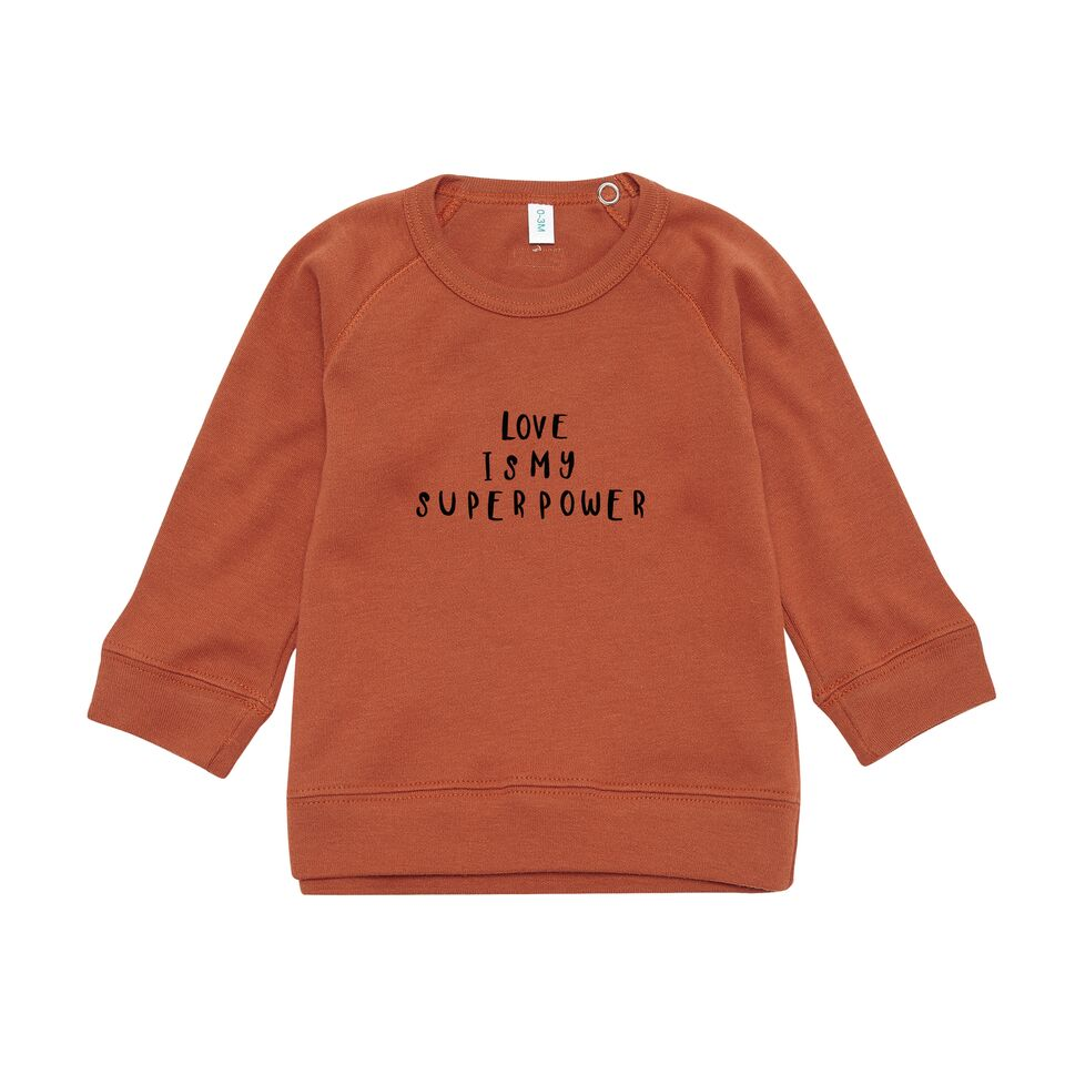 sweatshirt enfant en coton bio couleur rouille avec imprimé phrase love is my superpower