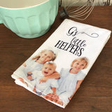 A Towel with a photo of three little girls on it that says Grandma's little helpers.
