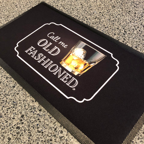 "Black bar mat with a glass of whiskey image and the caption, ""Call Me Old Fashioned"""