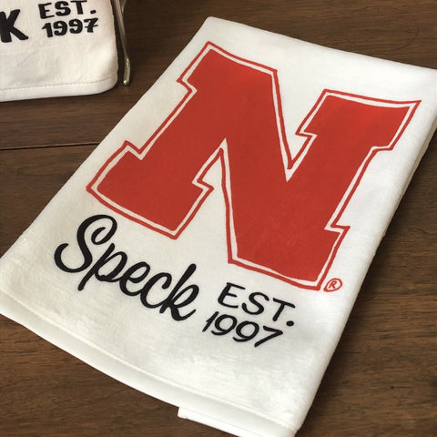 White Towel With a Red University of Nebraska N, personalized with a last name and established year.