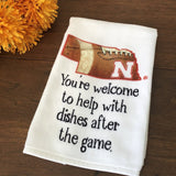 "Nebraska Football dishtowel that says, ""You're welcome to help with dished after the game."""