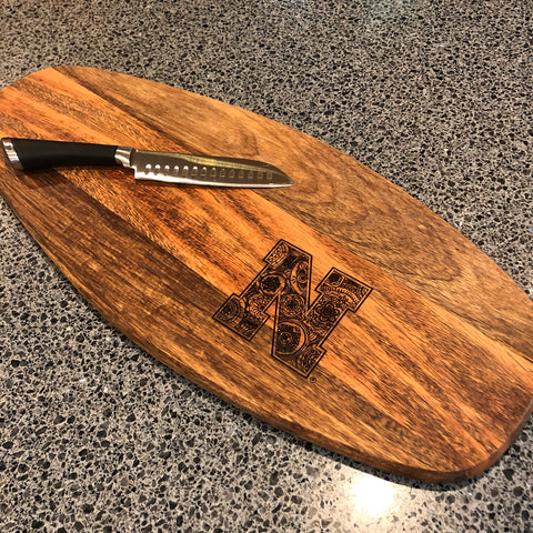 Beautiful oblong cutting board with a decorative zentangle/mandala collegiate N engraved in it.