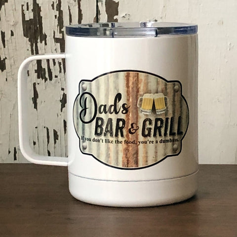 "A white steel Camp Mug that says, ""Dad's Bar & Grill...If you don't like the food, you're a dumbass"""