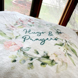 "Close Up Photo of the words, ""Hugs & Prayers"" and Beautiful Floral Print on a Plush Fleece Blanket"