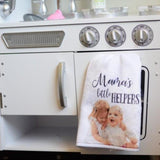 "A Kitchen towel with a photo of 2 little girls printed on it and it says, ""Mama's Little Helpers"""