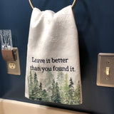 Leave It Better Than You Found It Hand Towel hanging in a bathroom.