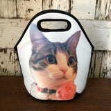 White Lunch tote with a photo of a Gray and white cat with a pink flower on it's collar.