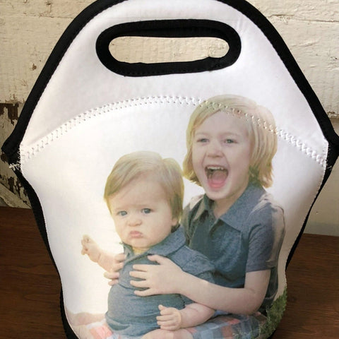 Lunch bag with a photo printed on it of 2 small children.
