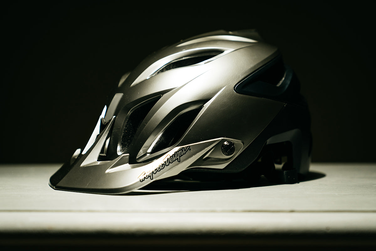 Studio shot of the Troy Lee Designs A3 helmet in silver against a black background