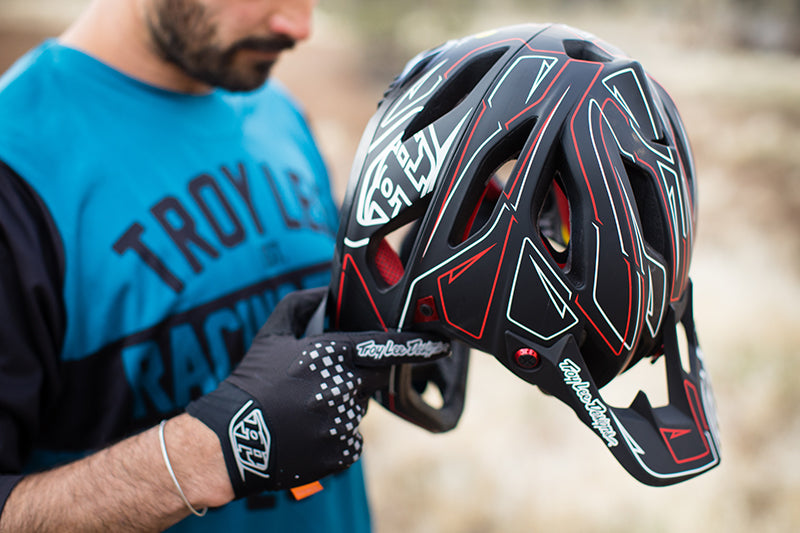 Close up of the side profile of the Troy Lee Designs Stage Born from Paint Pinstripe helmet in black, red and white.