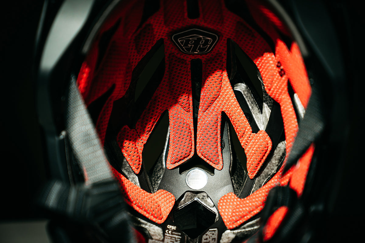 Studio photograph of the inside of the Troy Lee Designs A3 helmet showing the comfort liner