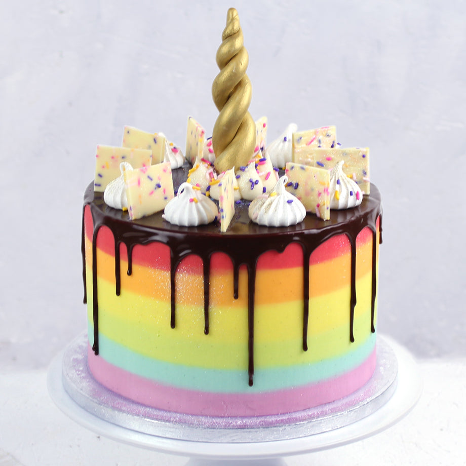 Rainbow Icing Unicorn Cake with Gold Unicorn Horn and Chocolate Drips