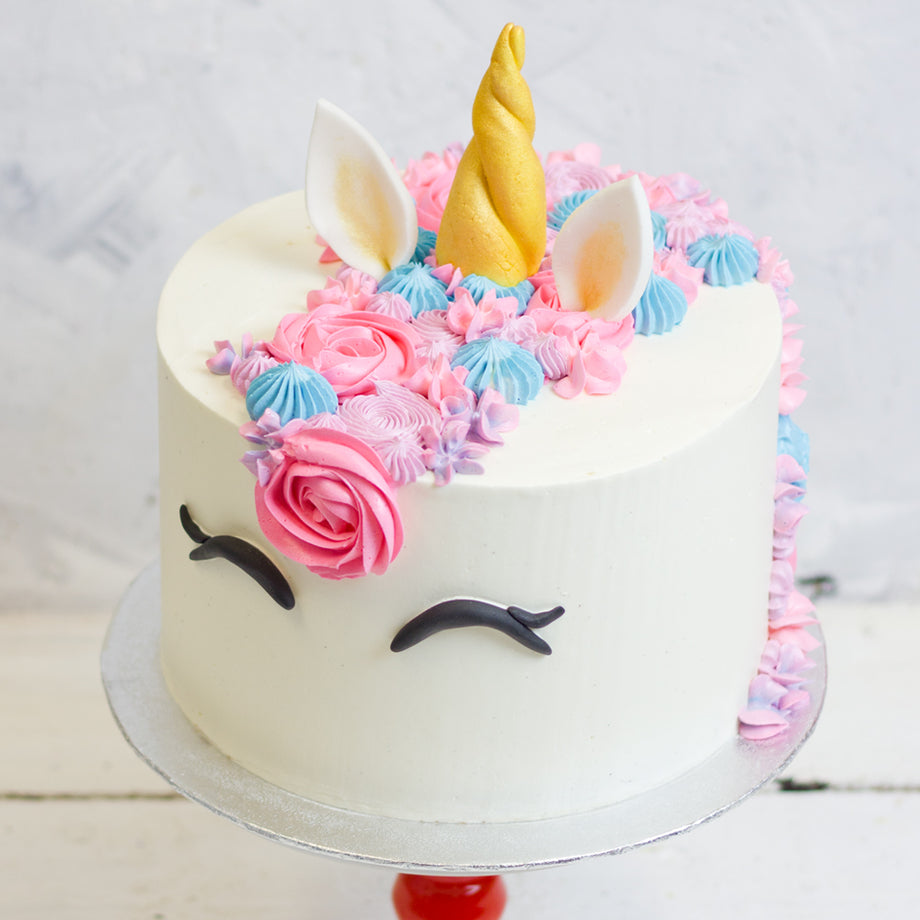 Unicorn Cake with Mythical Mane and Rainbow Sponge