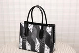 Sylvia Black Multi-Toned Embossed Handbag
