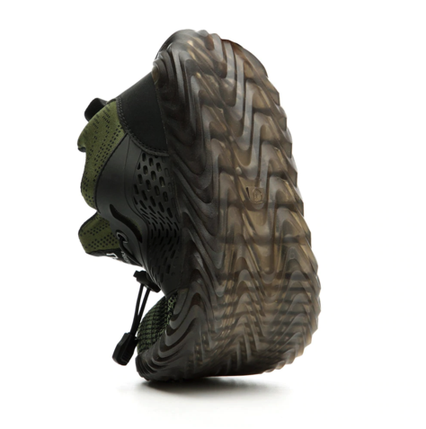 Green Defender Pro Shoe being bent to show flexibility of sole 480 x 479