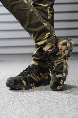 Person crossing legs wearing traditional camouflage Soldier shoes