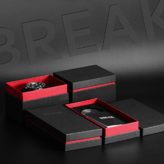unique red and black packaging of shutter series break watch on a back background