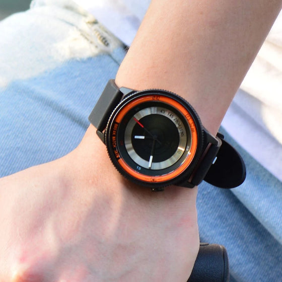 orange lens series break watch with silicone strap on a man wrist