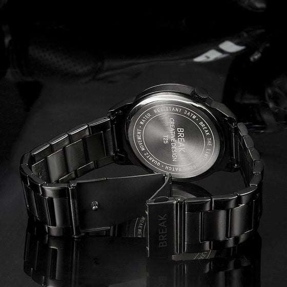 back side of lens series break watch with stainless steel strap on black background