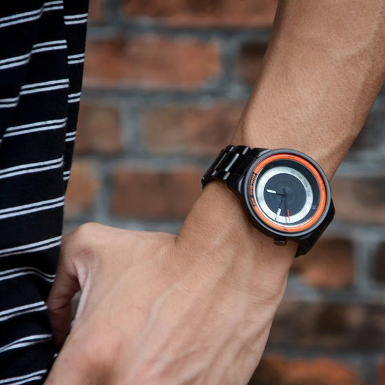 orange lens series break watch with stainless steel strap on a man wrist