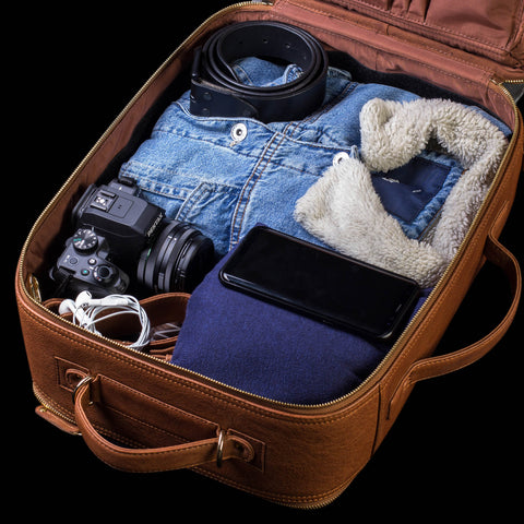 Travel luggage with travel items like clothes and camera in it