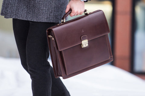 Man carrying classic leather briefcase