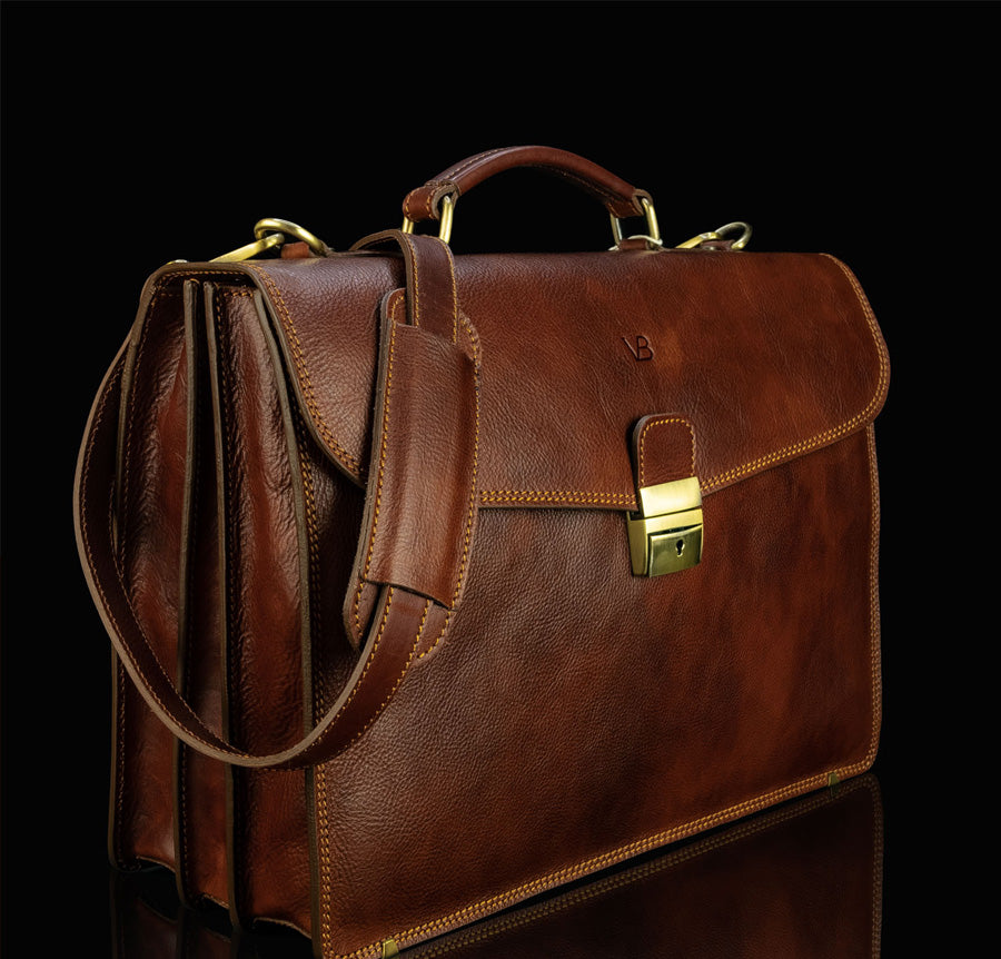 Brown leather briefcase with messenger strap