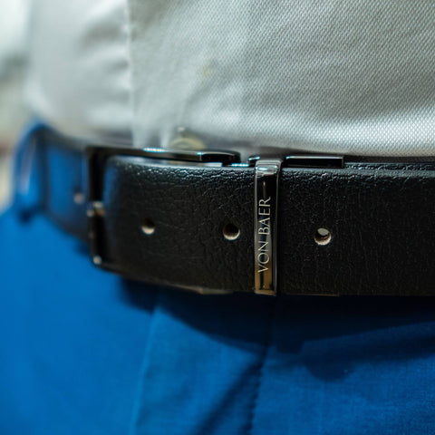 Leather belt on blue pants and white shirt