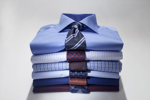 Different-shirts paired with ties placed on a white background
